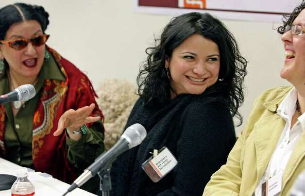 METRO  Sandra Cisneros gets a laught from fellow panelists Macarena del Rocio Hernandez (middle) and Christine Granados Saturday during their appearance at Hecho en Tejas, an anthology of Texas Mexican literature at Texas State University.  HECHO EN TEJAS TEXAS MEXICAN LITERATURE ANTHOLOGY AT TEXAS STATE UNIVERSITY   FEBRUARY 10, 2007.    TOM REEL/STAFF Photo: TOM REEL, SAN ANTONIO EXPRESS-NEWS / SAN ANTONIO EXPRESS-NEWS