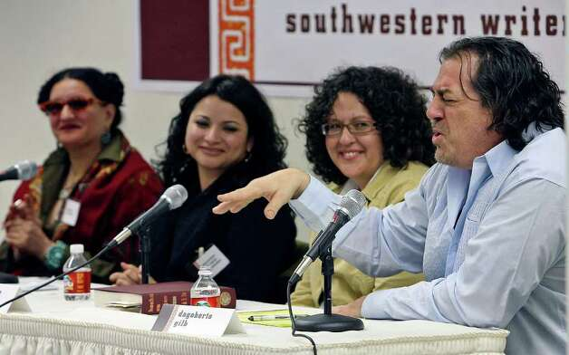METRO  Dagoberto Gilb (right) describes his start in writing  during a panel discussion of Texan Mexican literature Saturday at Texas State Univeristy.  Seated with him are (from left)  Sandra Cisneros, Macarena del Rocio Hernandez and Christine Granados.   HECHO EN TEJAS TEXAS MEXICAN LITERATURE ANTHOLOGY AT TEXAS STATE UNIVERSITY   FEBRUARY 10, 2007.    TOM REEL/STAFF Photo: TOM REEL, SAN ANTONIO EXPRESS-NEWS / SAN ANTONIO EXPRESS-NEWS