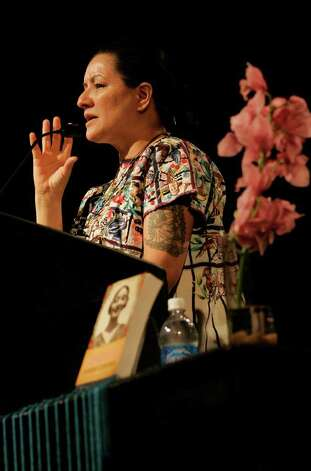 Author Sandra Cisneros reads her work at Thiry Auditorium at Our Lady of the Lake University Tuesday March 28, 2006.  MIKE KANE/PHOTO Photo: HELEN L. MONTOYA, SAN ANTONIO EXPRESS-NEWS /  © San Antonio Express-News
