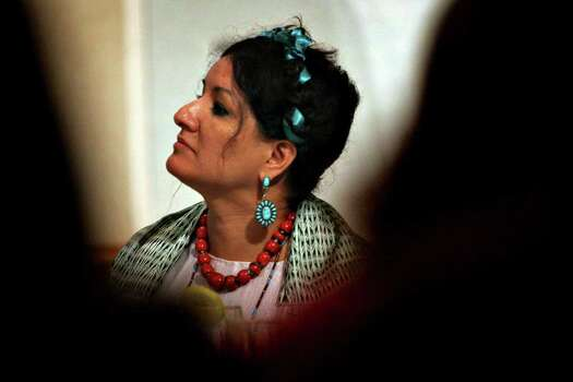Sandra Cisneros listens to the opening remarks during the Latina Letters conference in the University Center at St. Mary's University Thursday, July 14, 2005.  Nicole Fruge/San Antonio Express News Photo: NICOLE FRUGE, SAN ANTONIO EXPRESS-NEWS / SAN ANTONIO EXPRESS-NEWS