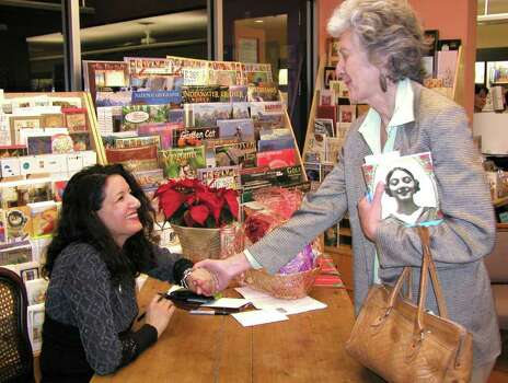 OTS/BROTHERS - Sandra Cisneros (author) and Joan Frederick (guest) were at the Twig Book Shop on 12/12/2002 for the book signing by Cisneros. names checked photo by leland a. outz Photo: LELAND A. OUTZ, SPECIAL TO THE EXPRESS-NEWS / SAN ANTONIO EXPRESS-NEWS