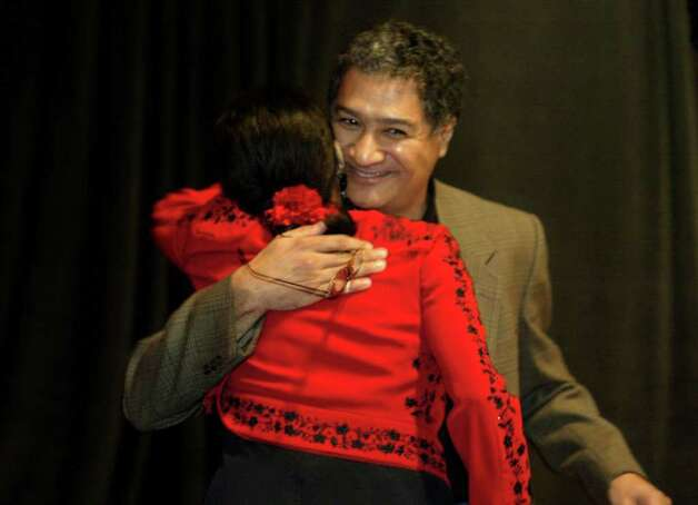 Author Sandra Cisneros reCeives a hug from her brother Enrique Cisneros after he introduced her at her book reading at the Mexican Fine Arts Center Museum in Chicago, Ill. Thursday, October 3, 2002.  (Photo by Peter Thompson/Special to the Express-News) Photo: PETER THOMPSON, SAN ANTONIO EXPRESS NEWS / SAN ANTONIO EXPRESS NEWS