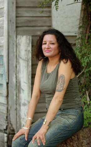 "SA LIFE - Author Sandra Cisneros has just released a new novel, ""Caramelo."" She relaxes for a portrait at the Liberty Bar. BILLY CALZADA / STAFF Photo: BILLY CALZADA, SAN ANTONIO EXPRESS-NEWS"