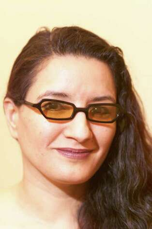 SANDRA CISNEROS FOR LA EYEWEAR FOR ARTS PACE. KIN MAN HUI/STAFF. Photo: KIN MAN HUI, EN / EN
