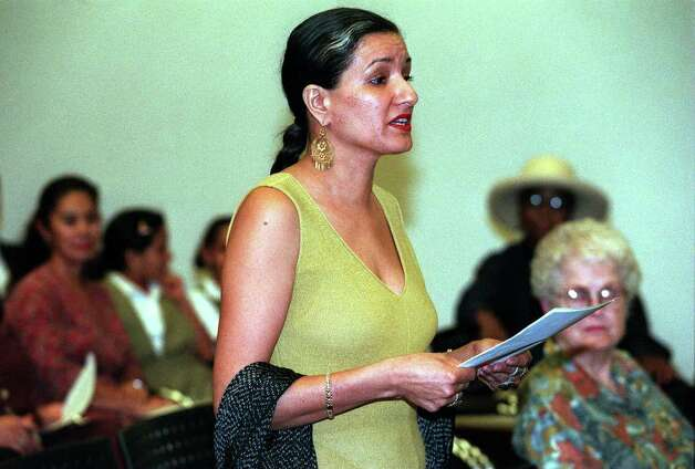 FOR DAILY METRO--Author and poet Sandra Cisneros reads her statement to the San Antonio Library board in reference to funding at branch libraries Wednesday afternoon at the Central Library.  Rick Hunter/Staff Photo: RICK HUNTER