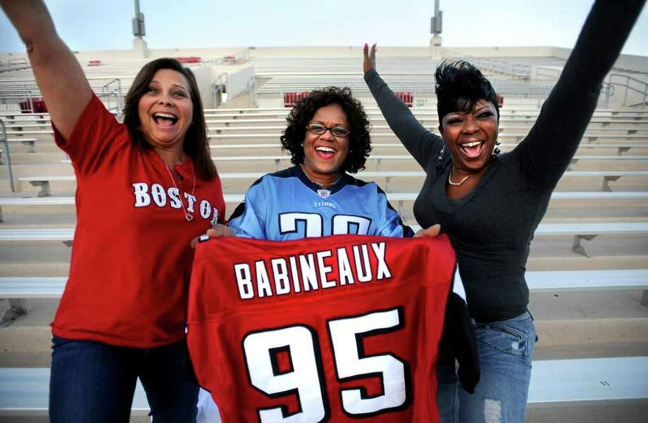 Robin Buchholz, Barbara Babineaux, and Yulander Randle, mothers of professional athlestes pose for a photo at the Provost Umphrey Stadium at Lamar in Beaumont, Thursday, October 27, 2011. Tammy McKinley/The Enterprise Photo: TAMMY MCKINLEY