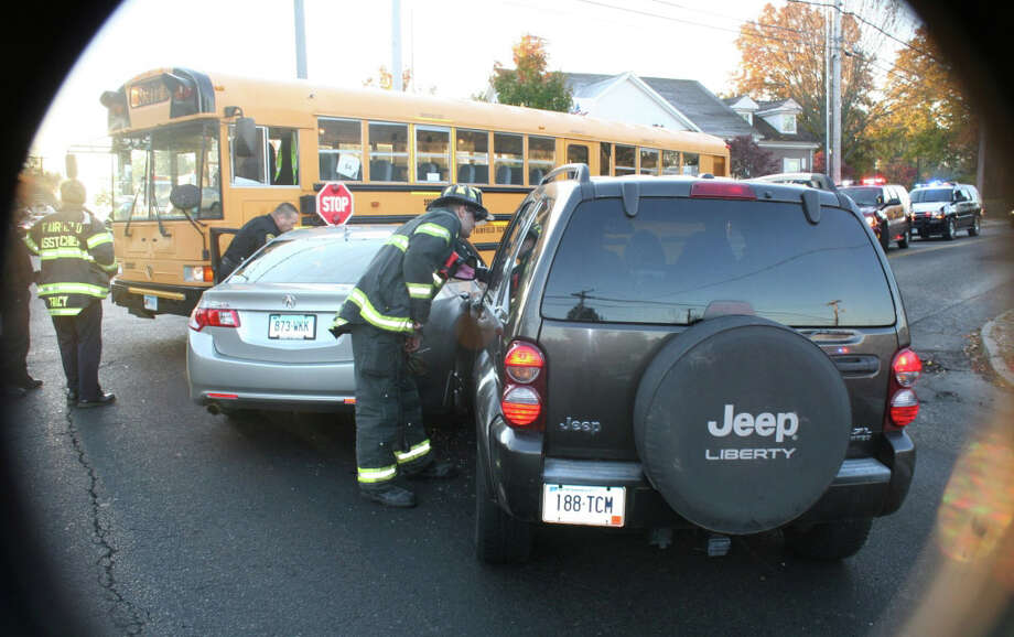 A school bus was hit by an Acura shortly before 8 a.m. on Wednesday, Nov. 2 at the intersection of Black Rock Turnpike and Burroughs Road. A Jeep Liberty subsequently hit the Acura. There were no children on the bus at the time of the accident, according to fire department officials. Photo: Contributed Photo / Fairfield Citizen contributed