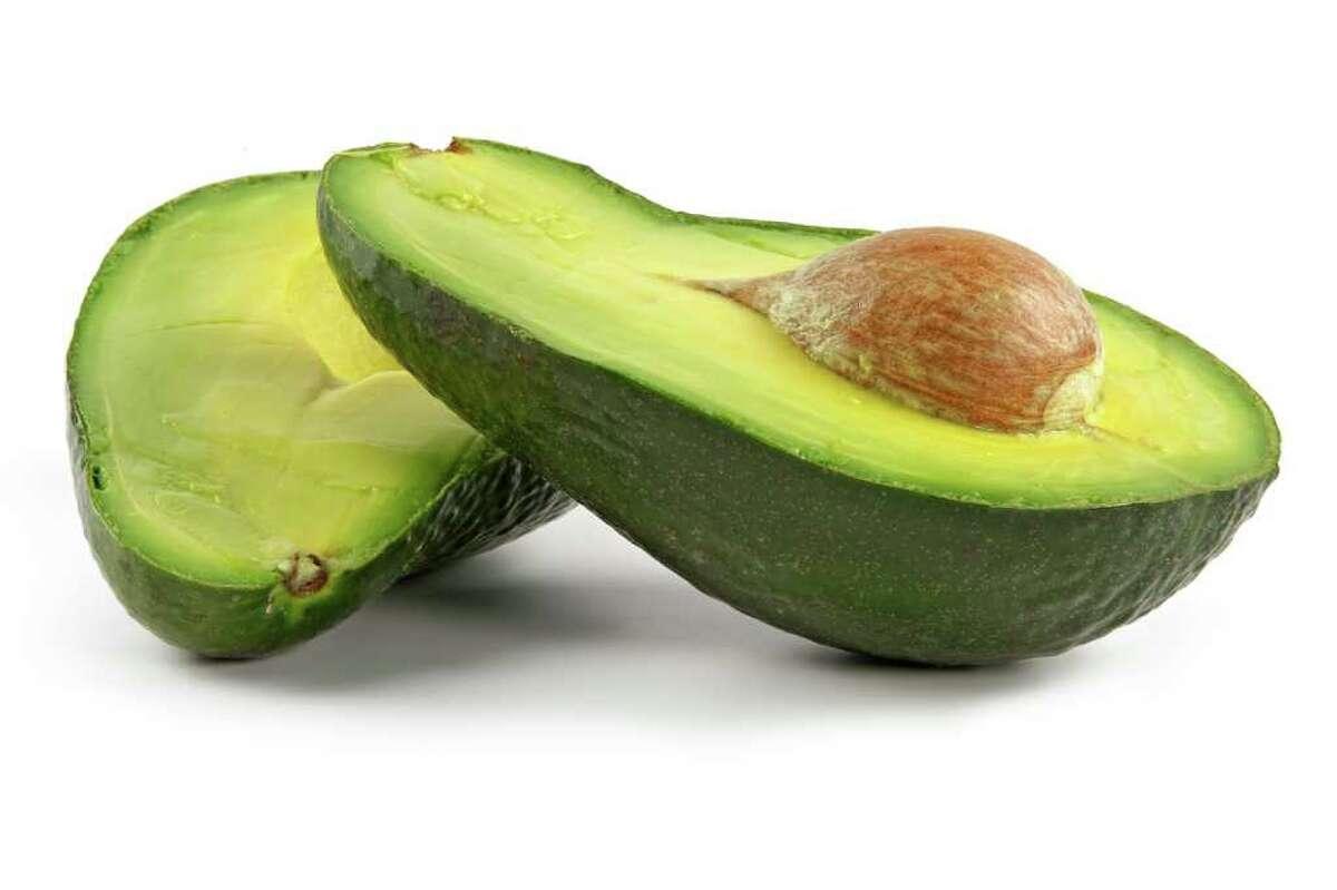 Avocado-oily nutritious fruit.Two fleshy halfs on white background