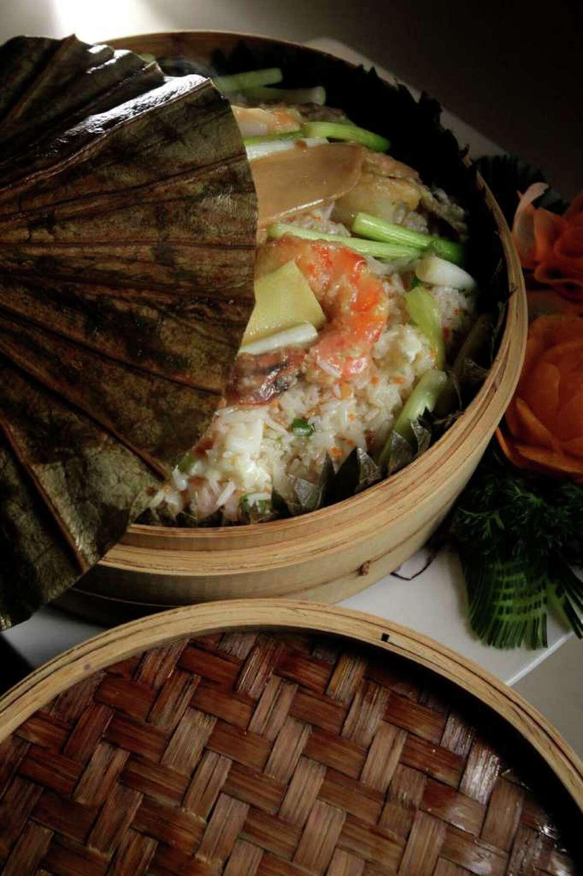 Prawns, seafood fried rice inside a lotus leaf