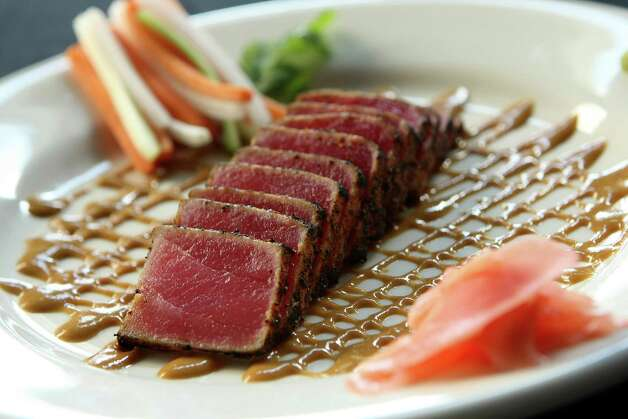 Wasabi Seared Tuna is flash-seared, then served with a zesty mustard sauce at Myron's Prime Steakhouse. Photo: HELEN L. MONTOYA, San Antonio Express-News / SAN ANTONIO EXPRESS-NEWS