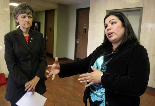 Benita Veliz (right) came to the U.S. on a visa when she was 8 and was facing deportation until prosecutors dropped the case against her. At left is her attorney, Nancy Shivers. Photo: JOHN DAVENPORT, SAN ANTONIO EXPRESS-NEWS