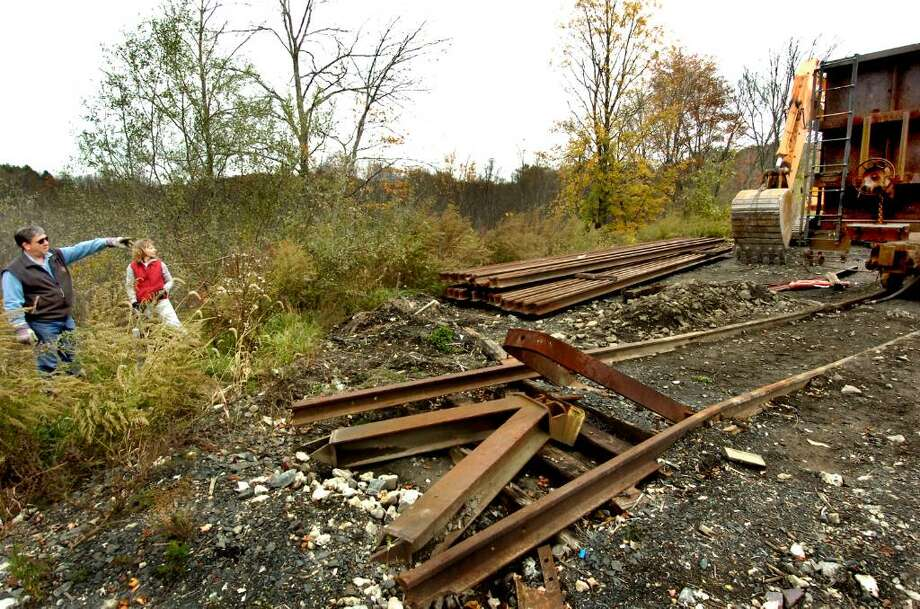 Newtown homeowners Howard and Catherine Winkler, standing between their property line and point of expansion, where Housatonic Railroad and Stamford Demolition plan to put 3,000 feet of double railroad track, on Saturday, Oct.17,2009. Photo: Michael Duffy / The News-Times