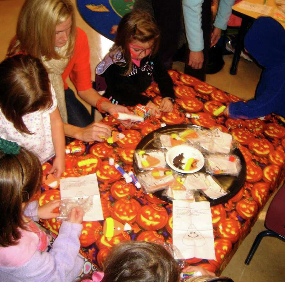 Kids enjoy making candy corn magnets at Darien Nature Center's recent Hoot and Howl. Photo: Contributed Photo