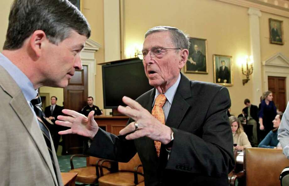 Supercommittee Co-Chairman Rep. Jeb Hensarling, R-Texas (left), talks with former Senate Budget Committee Chairman Pete Domenici prior to Domenici testifying before the panel. Photo: J. Scott Applewhite/Associated Press