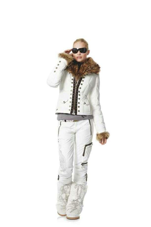 SNOW BUNNY: Ski hard, but look good in Bogner?s Sport Scarpa jacket with hood fur, $2,878; pants, $799; Leandra shirt, $349; and rabbit-fur boots, $699. All from Bogner.com. Photo: Bogner / Willy Bogner GmbH & Co.KGaA   -   www.bogner.com