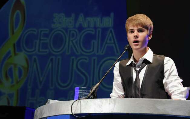 ATLANTA, GA - SEPTEMBER 17:  Justin Bieber accepts The Bill Lowery Horizon Award at the 33rd Annual Georgia Music Hall Of Fame Awards at the Cobb Energy Performing Arts Center on September 17, 2011 in Atlanta, Georgia. Photo: Rick Diamond, Getty Images / 2011 Getty Images