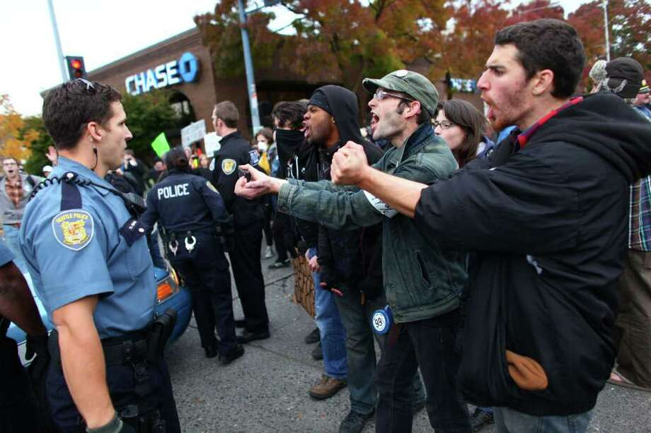 Protesters confront police during an Occupy Seattle protest outside a Chase Bank branch on Capitol Hill on Wednesday, Nov. 2, 2011. Photo: JOSHUA TRUJILLO / SEATTLEPI.COM