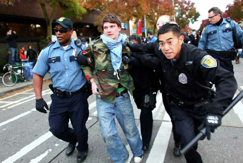 Police arrest a protester during an Occupy Seattle protest outside a Chase Bank branch on Capitol Hill on Wednesday, Nov. 2, 2011. Photo: JOSHUA TRUJILLO / SEATTLEPI.COM