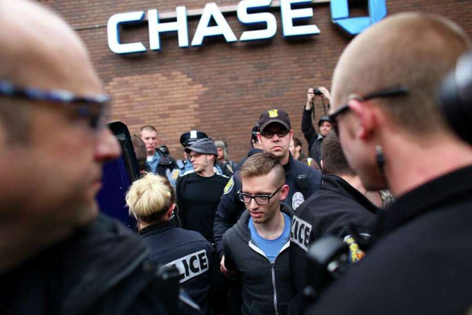 A man is arrested after locking himself to other protesters inside a Chase Bank during an Occupy Seattle protest on Capitol Hill on Wednesday, Nov. 2, 2011. Photo: JOSHUA TRUJILLO / SEATTLEPI.COM
