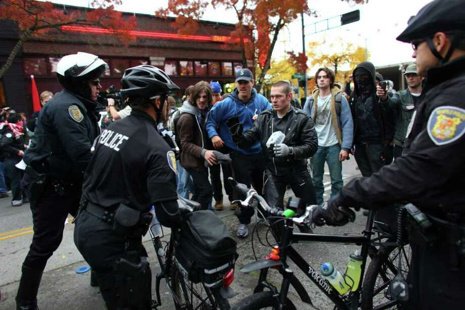 Police and protesters face off  during an Occupy Seattle protest outside a Chase Bank branch on Capitol Hill on Wednesday, Nov. 2, 2011. Photo: JOSHUA TRUJILLO / SEATTLEPI.COM