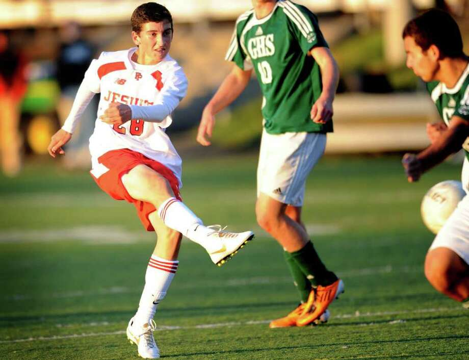Fairfield Prep's Luis Zamora takes a shot on goal as a Guilford defender tries, unsuccessfully, to block him Wednesday, Nov. 2, 2011 at Alumni Field on the campus of Fairfield University. Photo: Autumn Driscoll / Connecticut Post