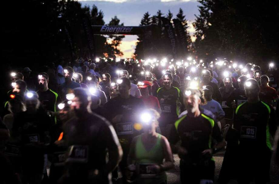 Organizers of the Energizer Night Race for a Brighter World have held several of the events worldwide, including this installment Aug. 13 in Calgary, Alberta. Photo: Todd KOROL