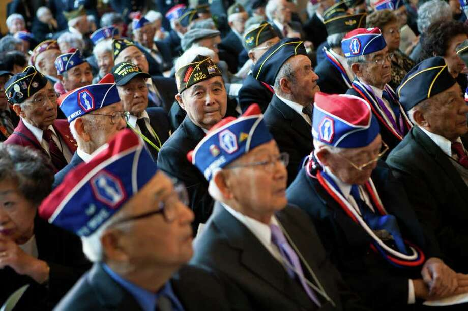 Japanese-American veterans of the 100th Infantry Battalion, 442 Regimental Combat Team, and the Military Intelligence Service, United States Army, await a ceremony in which they received the Congressional Gold Medal in recognition of dedicated service during World War II. Photo: Brendan Hoffman, Getty / 2011 Getty Images