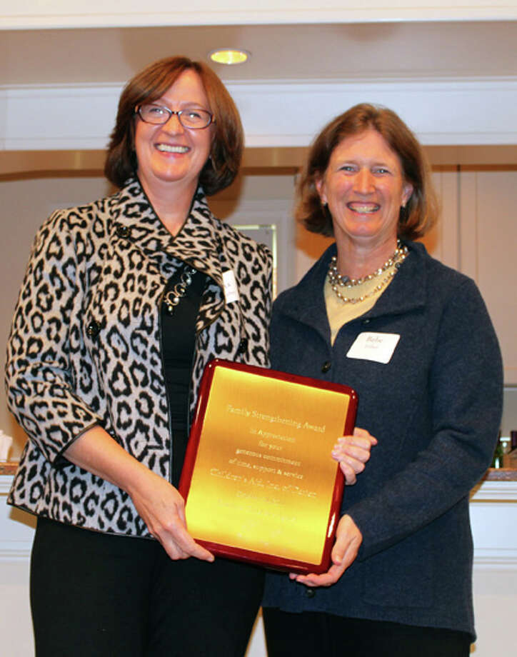 Childrenís Aid officers Rita Marber (left) and Bebe Fisher accept the 2011 Family Strengthening Award from Family & Childrenís Agency. Photo: Contributed Photo