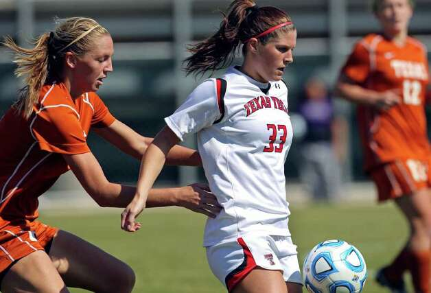 Tech's Casey McCall is followed by UT's Lucy Keith downfield during the 2011 Big 12 Soccer Championship tournament at Blossom Soccer Stadium on  November 2, 2011.  Tom Reel/Staff Photo: TOM REEL, Express-News / © 2011 San Antonio Express-News