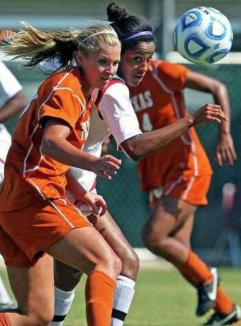 Tech's Erin Inman (center) contends with UT's Kristin Cummins (left) during the 2011 Big 12 Soccer Championship tournament at Blossom Soccer Stadium on  November 2, 2011.  Tom Reel/Staff Photo: TOM REEL, Express-News / © 2011 San Antonio Express-News