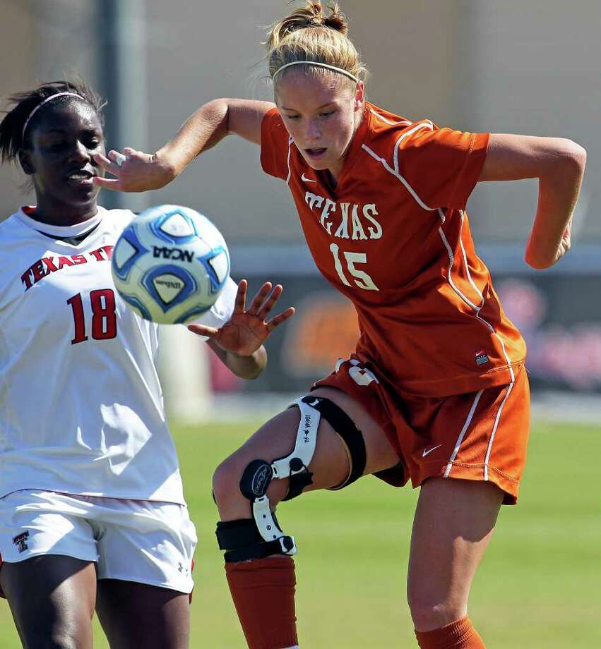 UT's Kylie Doniak dribbles in front of Tech's Morgan Johnson during the 2011 Big 12 Soccer Championship tournament at Blossom Soccer Stadium on  November 2, 2011.  Tom Reel/Staff Photo: TOM REEL, Express-News / © 2011 San Antonio Express-News