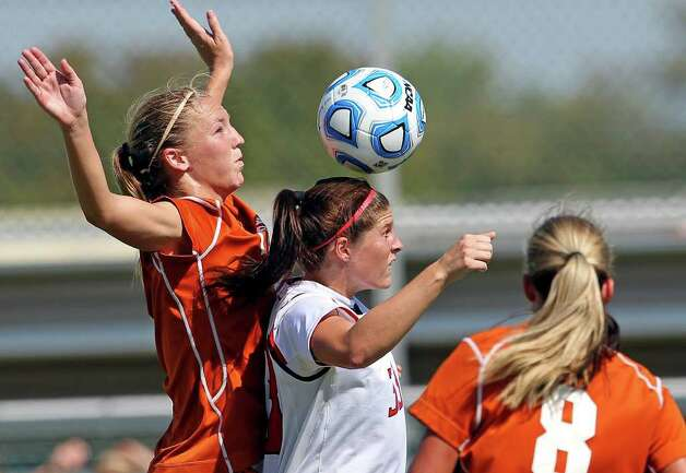 Tech's Casey McCall claims a header against UT's Lucy Keith (left) during the 2011 Big 12 Soccer Championship tournament at Blossom Soccer Stadium on  November 2, 2011.  Tom Reel/Staff Photo: TOM REEL, Express-News / © 2011 San Antonio Express-News