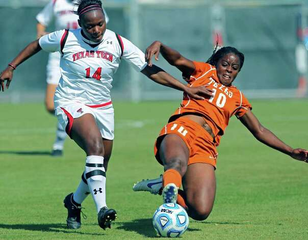 UT's Vanessa Ibewuike (10) puts a tackle on Tech's Tiffini Smith during the 2011 Big 12 Soccer Championship tournament at Blossom Soccer Stadium on  November 2, 2011.  Tom Reel/Staff Photo: TOM REEL, Express-News / © 2011 San Antonio Express-News