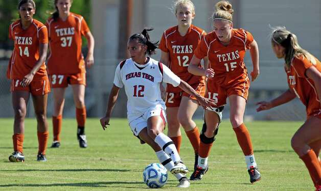 Surrounded by orange, Tech's Taylor Lytle looks for an opening upfield during the 2011 Big 12 Soccer Championship tournament at Blossom Soccer Stadium on  November 2, 2011.  Tom Reel/Staff Photo: TOM REEL, Express-News / © 2011 San Antonio Express-News