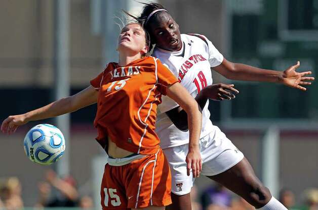 Texas player Kylie Doniak (15) and Texas Tech's Morgan Johnson slam heads together in pursuit of a loose ball during the 2011 Big 12 Soccer Championship tournament at Blossom Soccer Stadium on  November 2, 2011.  Tom Reel/Staff Photo: TOM REEL, Express-News / © 2011 San Antonio Express-News