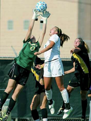 Missouri goalie McKenzie Sauerwein stops a shot infront of the goal with Baylor's Kat Ludlow contending during the 2011 Big 12 Soccer Championship tournament at Blossom Soccer Stadium on  November 2, 2011.  Tom Reel/Staff Photo: TOM REEL, Express-News / © 2011 San Antonio Express-News