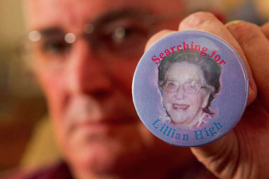 "Earl High has had buttons made to help in his search for his mother, 82-year-old Lillian High, who vanished Oct. 3 on her way to play bridge with friends. ""I will not stop until I find her,"" the Pasadena resident vows. Photo: Brett Coomer / © 2011 Houston Chronicle"