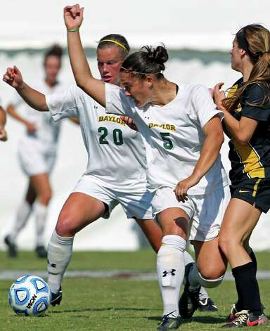 Baylor players Justine Hovden (20) and Lisa Sliwinski converge on the ball during the 2011 Big 12 Soccer Championship tournament at Blossom Soccer Stadium on  November 2, 2011.  Tom Reel/Staff Photo: TOM REEL, Express-News / © 2011 San Antonio Express-News
