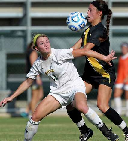 Baylor's Natalie Huggins (left) battles Missouri's Allison Hu for during the 2011 Big 12 Soccer Championship tournament at Blossom Soccer Stadium on  November 2, 2011.  Tom Reel/Staff Photo: TOM REEL, Express-News / © 2011 San Antonio Express-News