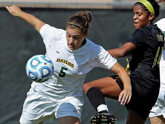 Baylor's Lisa Sliwinski tries to protect the ball from Missouri's Alyssa Diggs during the 2011 Big 12 Soccer Championship tournament at Blossom Soccer Stadium on  November 2, 2011.  Tom Reel/Staff Photo: TOM REEL, Express-News / © 2011 San Antonio Express-News