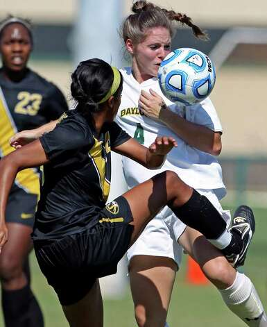 Missouri's Alyssa Diggs kicks the ball into Baylor's Carlie Davis during the 2011 Big 12 Soccer Championship tournament at Blossom Soccer Stadium on  November 2, 2011.  Tom Reel/Staff Photo: TOM REEL, Express-News / © 2011 San Antonio Express-News