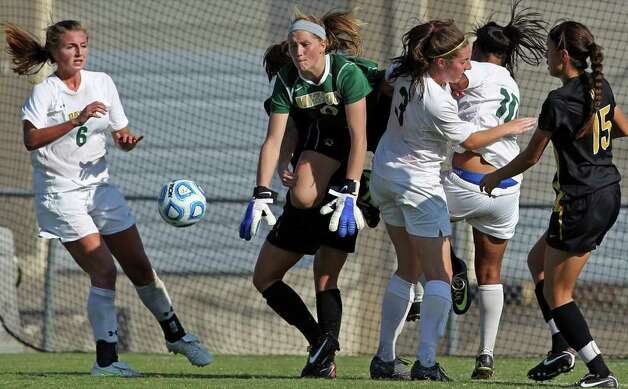 Missouri goal keeper McKenzie Sauerwein bumps away a Baylor shot on goal during the 2011 Big 12 Soccer Championship tournament at Blossom Soccer Stadium on  November 2, 2011.  Tom Reel/Staff Photo: TOM REEL, Express-News / © 2011 San Antonio Express-News
