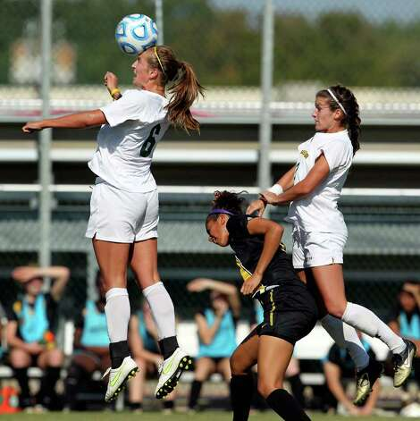 Baylor's Kat Ludlow controls the header as teammate Hanna Gilmore checks Missouri's Dominique Richardson during the 2011 Big 12 Soccer Championship tournament at Blossom Soccer Stadium on  November 2, 2011.  Tom Reel/Staff Photo: TOM REEL, Express-News / © 2011 San Antonio Express-News