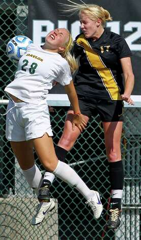 Baylor's Karlee Summey (28) and Missouri's Kelsey Blincow ight for control during the 2011 Big 12 Soccer Championship tournament at Blossom Soccer Stadium on  November 2, 2011.  Tom Reel/Staff Photo: TOM REEL, Express-News / © 2011 San Antonio Express-News