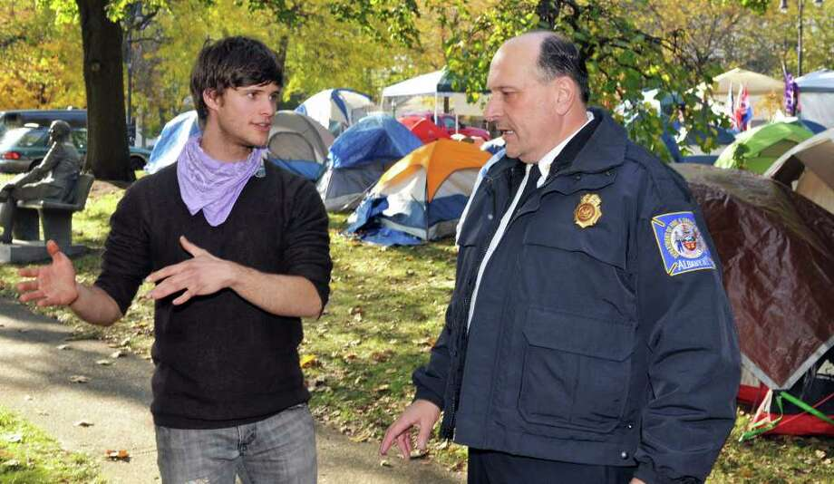 Daniel Morrisey, left,  of Albany, an Occupy Albany organizer answers safety questions from Albany Fire Chief Robert Forezzi during an inspection tour of the Occupy site at Academy Park in Abany Wednesday Nov. 2, 2011.    (John Carl D'Annibale / Times Union) Photo: John Carl D'Annibale