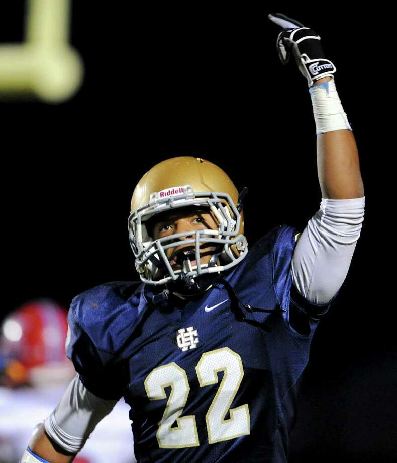 Holy Cross senior running back Hasan Ali celebrates after scoring a touchdown during a TAPPS 2-I football game between Antonian and Holy Cross In San Antonio, Oct. 29, 2011. Photo: Express-News