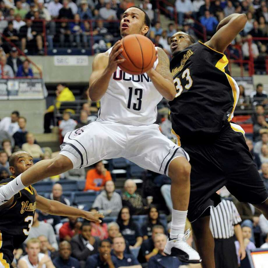 Connecticut's Shabazz Napier rises up past American International's Braxton Gardner for a shot in the second half of an NCAA college basketball exhibition game Wednesday, Nov. 2, 2011, in Storrs, Conn. Connecticut defeated American International 78-35. (AP Photo/Bob Child) Photo: Bob Child/Associated Press / FRE 170410 AP
