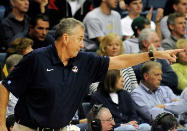 Connecticut head basketball coach Jim Calhoun yells directions to his players in the second half of an NCAA college basketball exhibition game Wednesday, Nov. 2, 2011, in Storrs, Conn. Connecticut defeated American International 78-35. (AP Photo/Bob Child) Photo: Bob Child/Associated Press / FRE 170410 AP