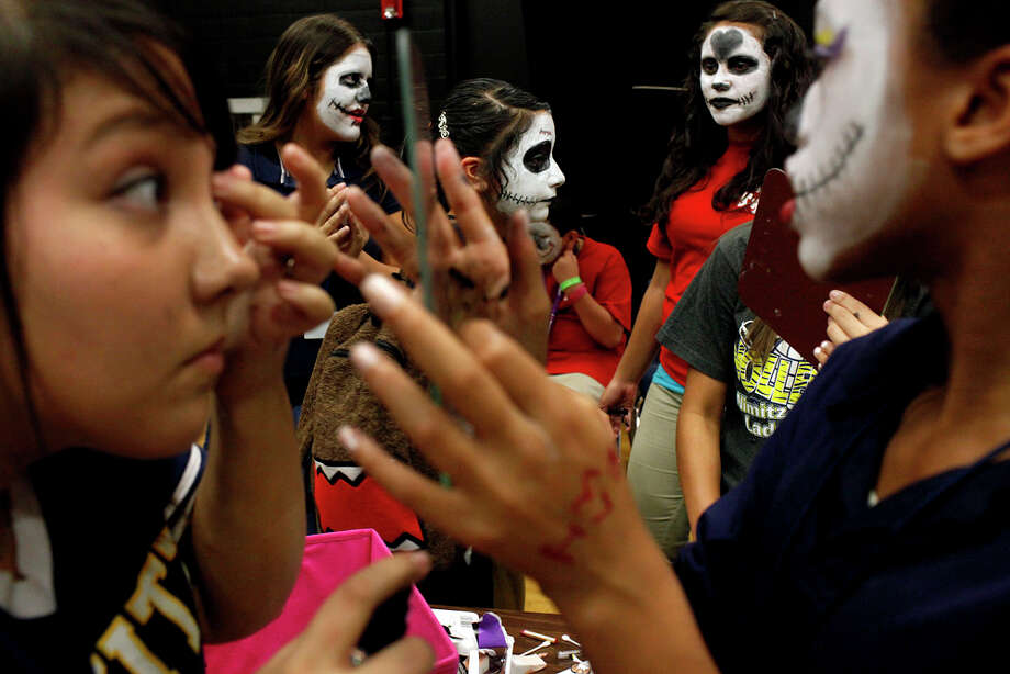 Eighth grade Theater Arts students including, Julianna Tharp (from left) Iris Longoria, Mariana Martinez, Angelica Ramirez, and Eve Younger, prepare for the Dia de los Muertos parade at Nimitz Middle School in San Antonio on Nov. 2, 2011. Photo: LISA KRANTZ / lkrantz@express-news.net