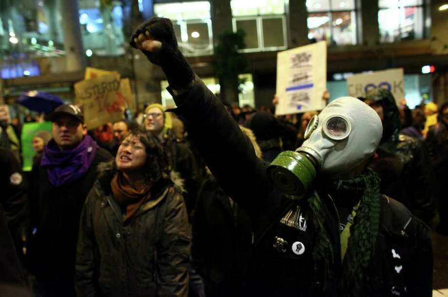 Protesters chant during an Occupy Seattle protest outside the Sheraton Hotel where JPMorgan Chase CEO Jamie Dimon was speaking. Photo: JOSHUA TRUJILLO / SEATTLEPI.COM